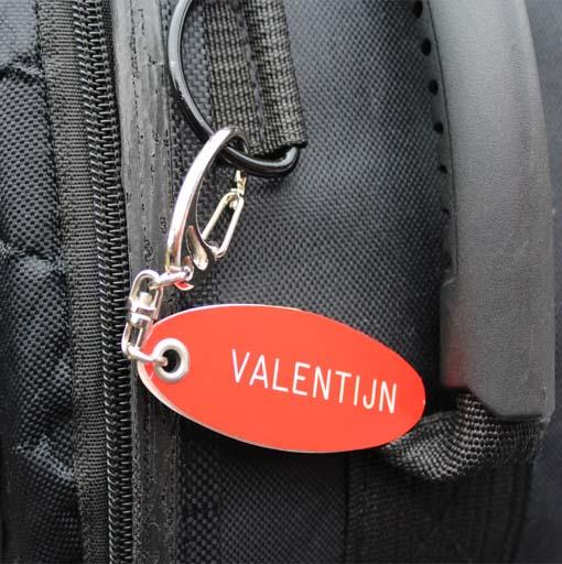 Naamlabel voor aan je fietssleutel of sport tas met je gegevens gegraveerd
