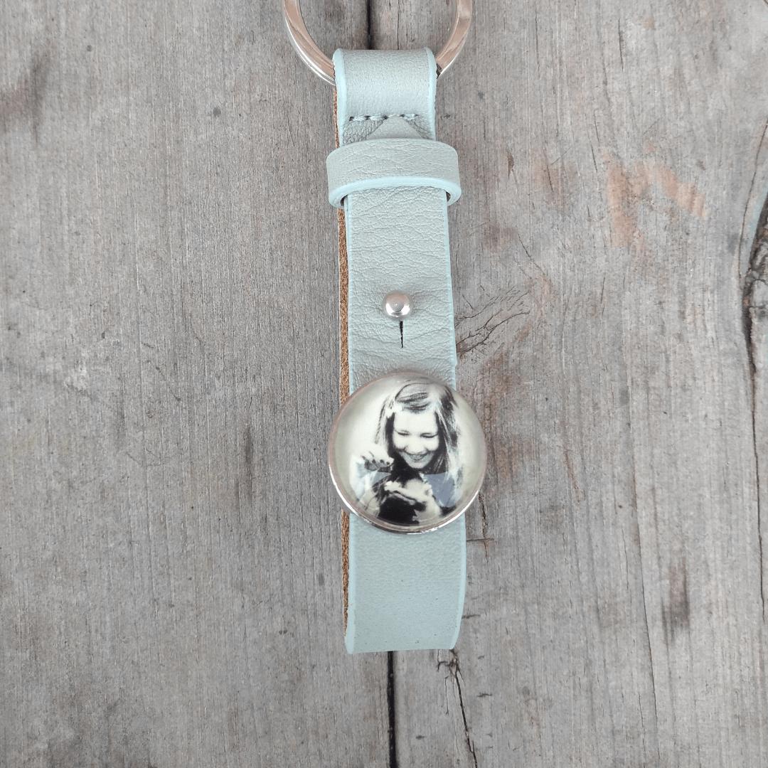 Een of meerdere foto sliders aan een sleutelhanger