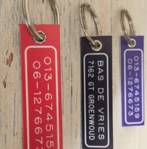 Tas met sleutelhanger (voorzien van naam)