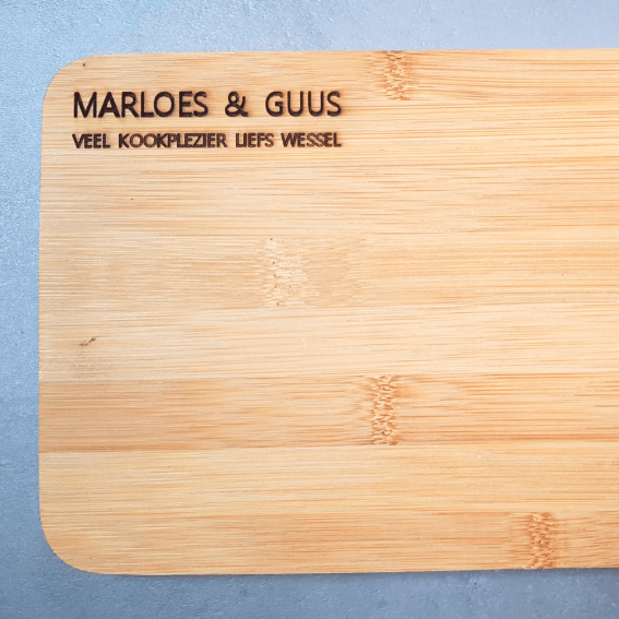 Tekst op een houten plank